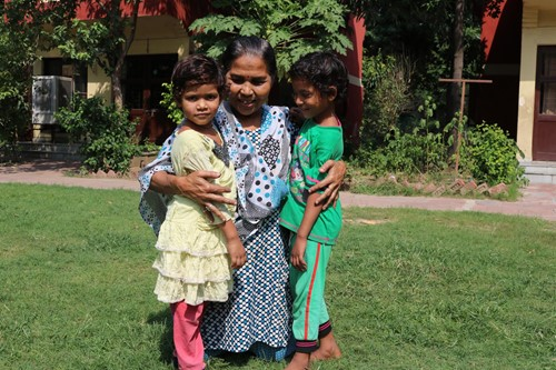 India_CV Faridabad_SOS mother hugging girls outdoors_RMiller-5.JPG